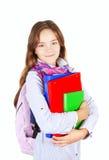 Adolescente con lo zaino ed i libri sopra bianco Fotografia Stock