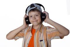 Adolescente con los auriculares Fotos de archivo