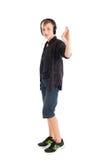 Adolescente con los auriculares que muestran la autorización de la muestra Imagen de archivo libre de regalías
