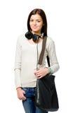 Adolescente con los auriculares y el bolso Foto de archivo libre de regalías