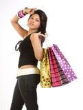 Adolescente con los bolsos de compras Imágenes de archivo libres de regalías