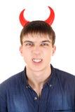 Adolescente con los cuernos del diablo Fotografía de archivo libre de regalías