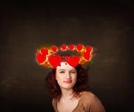 adolescente con los ejemplos del corazón circleing alrededor de su cabeza Imagen de archivo libre de regalías