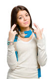 Adolescente con los fingeres cruzados Foto de archivo