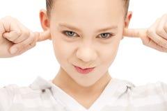 Adolescente con los fingeres en oídos Imagen de archivo