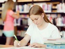 Adolescente con los libros Fotografía de archivo libre de regalías