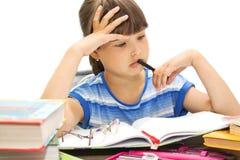 Adolescente con los libros en un fondo blanco, Foto de archivo libre de regalías