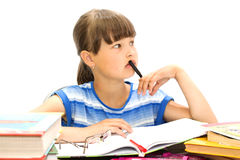 Adolescente con los libros en un fondo blanco, Fotografía de archivo