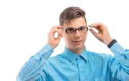 Adolescente con los nuevos vidrios en los ojos aislados Imágenes de archivo libres de regalías