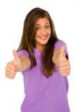 Adolescente con los pulgares para arriba Fotografía de archivo libre de regalías