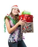 Adolescente con los regalos de la Navidad Foto de archivo
