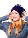 Adolescente con música que escucha de los auriculares Foto de archivo
