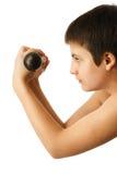Adolescente con pesas de gimnasia Fotos de archivo