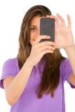 Adolescente con smartphone Fotografía de archivo libre de regalías