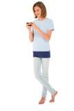 Adolescente con smartphone Imágenes de archivo libres de regalías