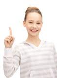 Adolescente con su finger para arriba Fotografía de archivo libre de regalías
