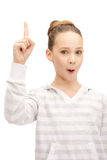 Adolescente con su finger para arriba Imagen de archivo libre de regalías