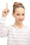 Adolescente con su finger para arriba Imágenes de archivo libres de regalías