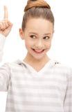 Adolescente con su finger para arriba Imagen de archivo