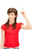 Adolescente con su finger para arriba Imagenes de archivo