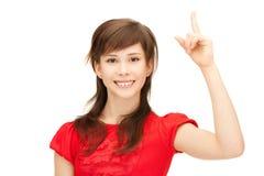 Adolescente con su finger para arriba Fotos de archivo libres de regalías