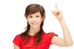 Adolescente con su finger para arriba Fotos de archivo