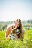Adolescente con su perro Imágenes de archivo libres de regalías