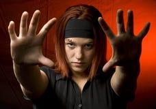 Adolescente con sus manos contra la cámara Imágenes de archivo libres de regalías