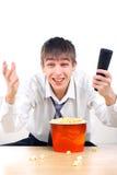 Adolescente con teledirigido Imágenes de archivo libres de regalías