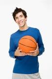 Adolescente con un baloncesto Fotografía de archivo