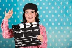 Adolescente con un clapperboard de la película Fotografía de archivo