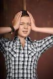 Adolescente con un'emicrania Fotografia Stock