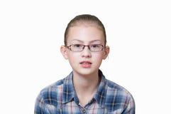 Adolescente con un'espressione divertente sul suo fronte Immagine Stock