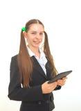 Adolescente con un libro electrónico Imagenes de archivo