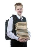 Adolescente con un montón de libros de texto Fotografía de archivo libre de regalías