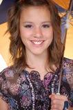 Adolescente con un paraguas Fotografía de archivo libre de regalías