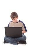 Adolescente con una computadora portátil Fotografía de archivo