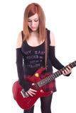 Adolescente con una guitarra eléctrica en la parte posterior del blanco Fotos de archivo libres de regalías