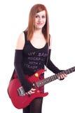 Adolescente con una guitarra eléctrica en la parte posterior del blanco Imágenes de archivo libres de regalías