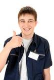Adolescente con una insignia en blanco Fotos de archivo