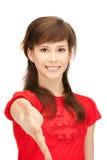 Adolescente con una mano abierta lista para el apretón de manos Fotos de archivo libres de regalías