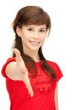 Adolescente con una mano abierta lista para el apretón de manos Imágenes de archivo libres de regalías