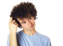 Adolescente con una mirada pensativa en su cara. Foto de archivo libre de regalías