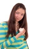 Adolescente con una rosa. Foto de archivo libre de regalías