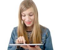 Adolescente con una tableta digital Imagen de archivo