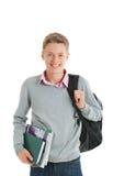Adolescente con uno zaino ed i libri di scuola Fotografia Stock Libera da Diritti