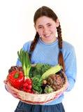 adolescente con verduras Imagenes de archivo