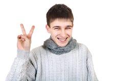 Adolescente con Victory Gesture Imagen de archivo