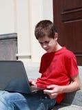 Adolescente concentrado Fotografía de archivo libre de regalías