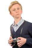 Adolescente confiado con la cámara retra Imagen de archivo